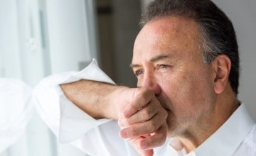 Serious concerned caucasian mature man posing looking away