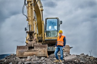 stock-photo-51067910-earth-digger-driver