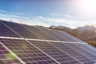 stock-photo-52037558-solar-panels-against-a-sunny-sky-with-sun-flares