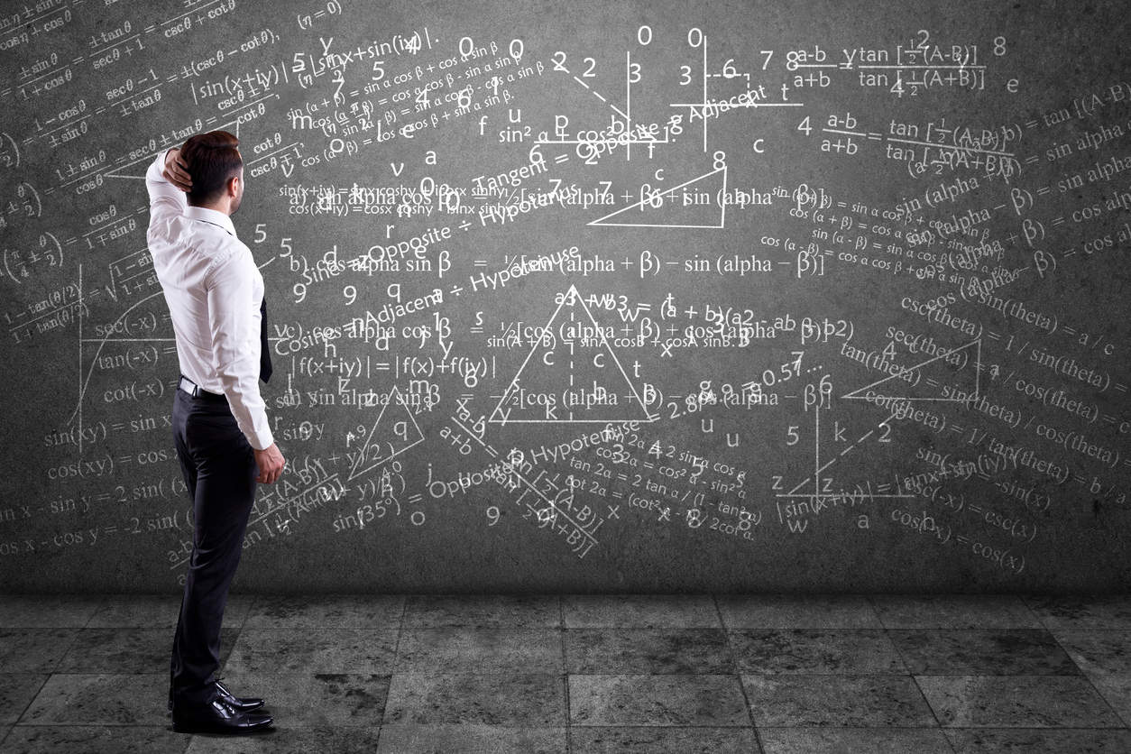 Businessman solving mathematical equation